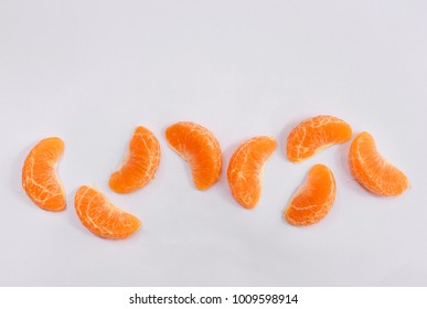 Pieces of oranges on white background.