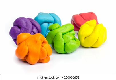 pieces of plasticine on white background
