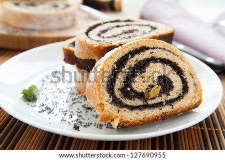 pieces of poppy seed cake on a plate, closeup