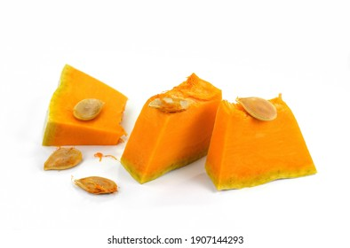 Pieces of pumpkin isolated on white background. Pumpkin seed. Pumpkin pieces cut in a cube slice isolated on white background.