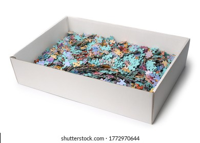 Pieces of a puzzle in box on white background
