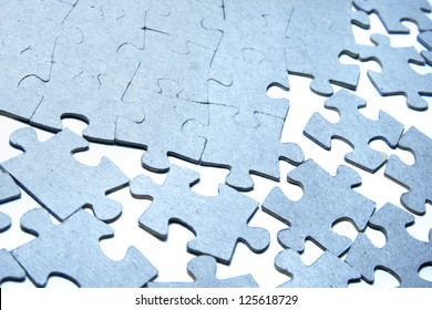 Pieces of puzzle close up.
