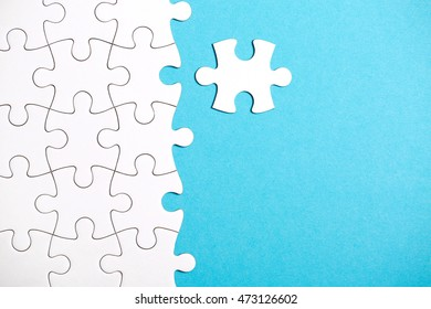 Pieces of puzzle connected together on pink background.