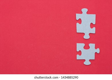 Pieces of the puzzle on red background.