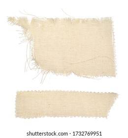 Pieces of ragged burlap shreds. Rectangular canvas patches. Texture background fabric in beige color isolated on a white background. The patch, cloth, garbage, dry waste, scraps of clothing.