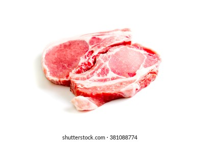 Pieces of raw beef isolated on white background