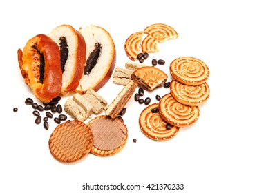 Pieces of  Roll with Poppy seed,Cookies,Paste,Chocolate Peas.Sweets on the White Background.Top View