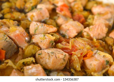 pieces of salmon sauteed with onions