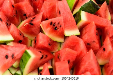 Pieces of sliced watermelon, red fresh fruit.