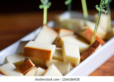 Pieces of smoked georgian suluguni cheese in a bowl with copy space