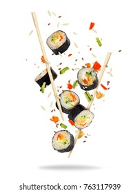 Pieces of sushi frozen in the air on white background