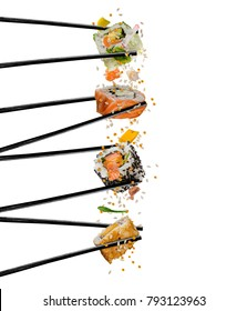 Pieces of sushi with wooden chopsticks, separated on white background. Flying food and motion concept. Very high resolution image