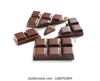Pieces of tasty dark chocolate on white background