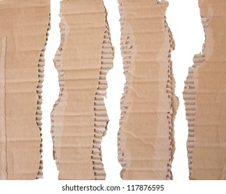 Pieces of torn brown corrugated  detailed cardboard