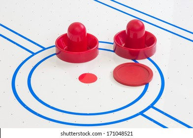 Pieces of a toy table hockey game
