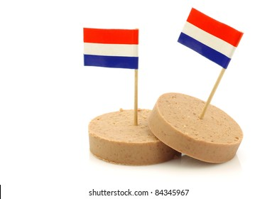 pieces of traditional Dutch  liver sausage with a Dutch flag toothpick on a white background