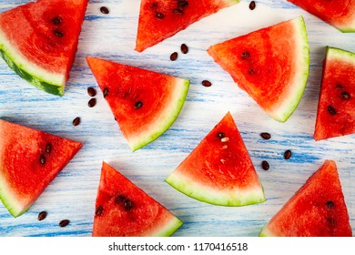 Pieces of watermelon on a blue wooden table. Delicious dessert.