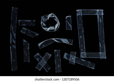 Pieces of white transparent tape isolated on black background