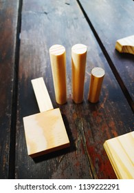 Pieces of wood with geometric shapes on a wooden vitage table.