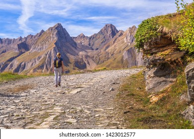 [Piedmont, Italy / Jun 01 2019] Young couple hiking in the mountains, val Formazza, Piedmont, Italy