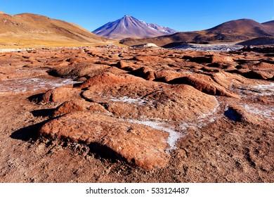 Piedras Rojas with Vulcano Miniques in background. Atacama, Chile