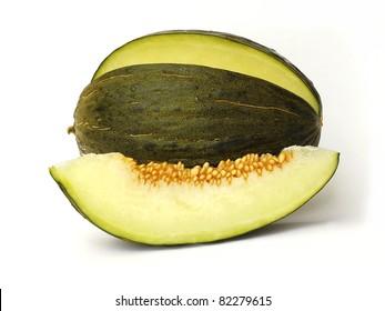 Piel de sapo melon and a slice on white background