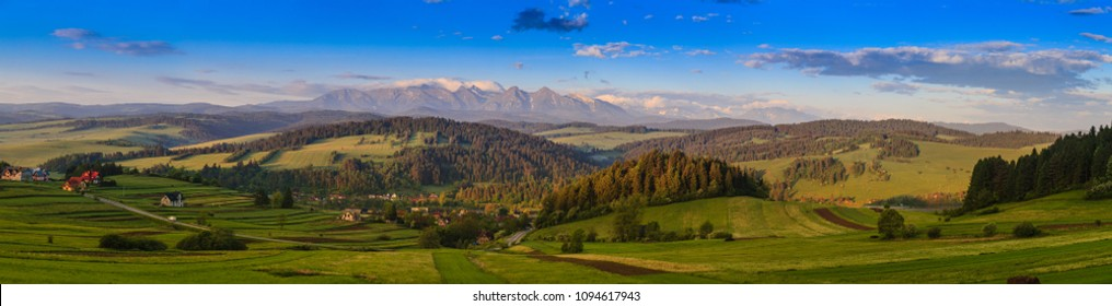 Pieniny Panorama with a view of the Tatras at sunrise.