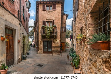 Pienza, Italy - August 20, 2017:  Traditional Houses in the old village of Pienza in Tuscany - A UNESCO World Heritage Site.