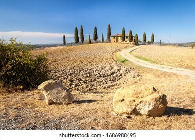 PIENZA, ITALY - JULY 30, 2012: Idyllic traditional tuscan countryside near Pienza, Tuscany, Italy.