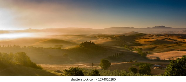 Pienza, Italy - July 7 2017: The beautiful   hilly scenery in the morning at Val d'Ocia, Tuscany.