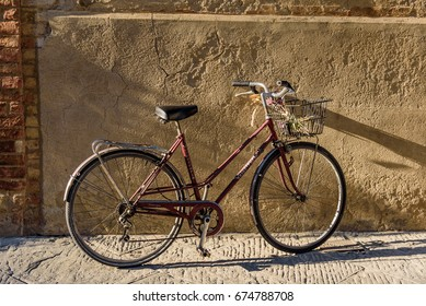PIENZA, ITALY - JUNE 02, 2017 -   Bicycle holder resting in stone wall