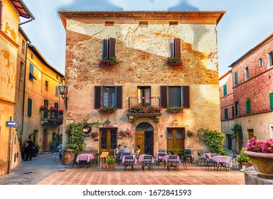 PIENZA, ITALY - JUNE 23: View of the picturesque Piazza di Spagna, in Pienza, Tuscany, Italy on June 23, 2019. Pienza was declared as a World Heritage Site by UNESCO in 1996
