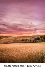PIENZA, ITALY - JUNE 25, 2015: Purple sunset in Tuscany. Countryside landscape.
