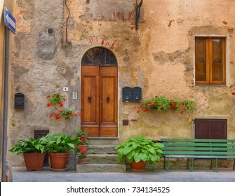 Pienza, Italy – May 27, 2017: Traditional façade of Italian house in the small magical and old village of Pienza, Val D'Orcia Tuscany