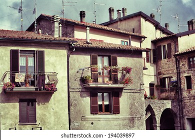 Pienza, Italy. Typical medieval archetecture in the small old town in Tuscany. Filtered image in vintage style