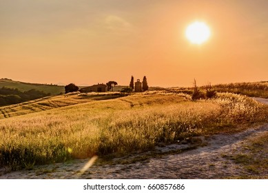 PIENZA, SIENNA - JUNE 02, 2017 -  An extraordinary sunset over the hills of the Tuscan valley, with fields of wheat immersed in the shadows of the sun