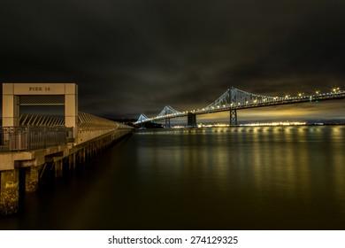 Pier 14 and Bay Bridge at night