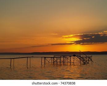 Pier in Balaton in sunset