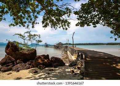 Pier beach with beautiful sea and blue sky at Ao Pra beach, Koh Mak island, Trat, Thailand