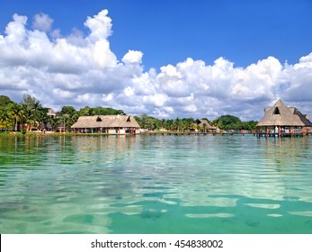 Pier and beach canopies on Laguna Bacalar, Mexico