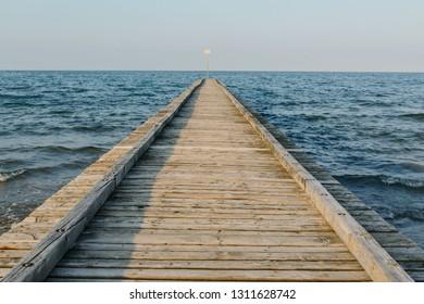 Pier Beach of Lido di Jesolo at adriatic Sea in a beautiful summer day Italy