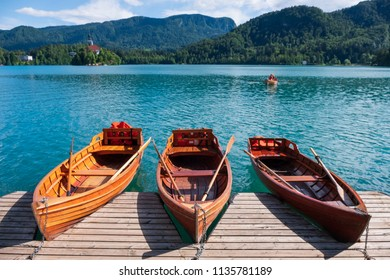 Pier with boats on a famous Bled lake in Slovenia. Popular summer tourist destination