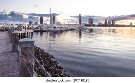 Pier with Boats and Yachts Reflecting in the Canal and Overlooking Southport During a Beautiful Sunset, Main Beach, Gold Coast, Queensland, Australia