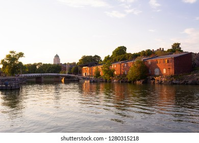 Pier, bridge and ancient fortifications of Suomenlinna-Fort Suomenlinna in the Gulf of Finland in Finland on a summer evening.