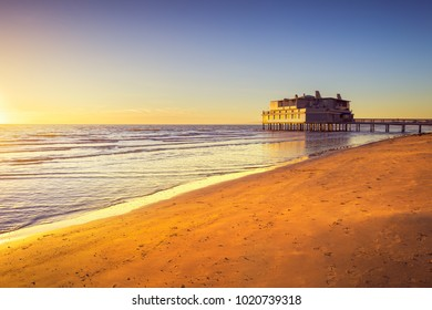 Pier and building on sea water and beach. Follonica travel destination in Maremma, Tuscany, Italy Europe