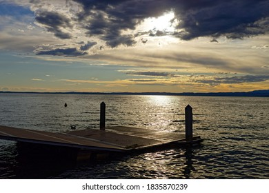 A Pier by the Lake in the Sunset