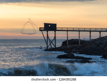 Pier and cabins for fishing in the atlantic ocean near Nantes in France.