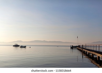 Pier and calm water overlooking Lake Tahoe, California during sunrise