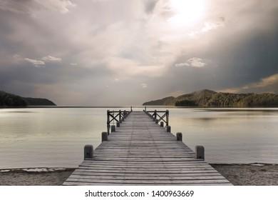 Pier in calm waters. Lago Grande lake, Bariloche, Argentina.