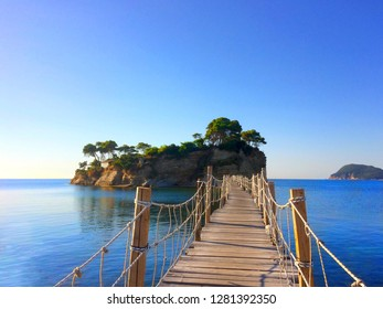 """Pier to Cameo Island in Zakinthos, Greece. Marathonisi """"the Turtle island"""" is visible in the background."""
